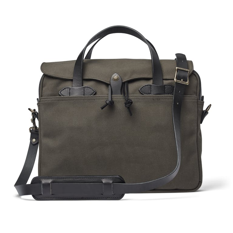 The Filson legendary Original Briefcase is built with signature Rugged Twill and Bridle Leather. It resists water and handles wear and tear.