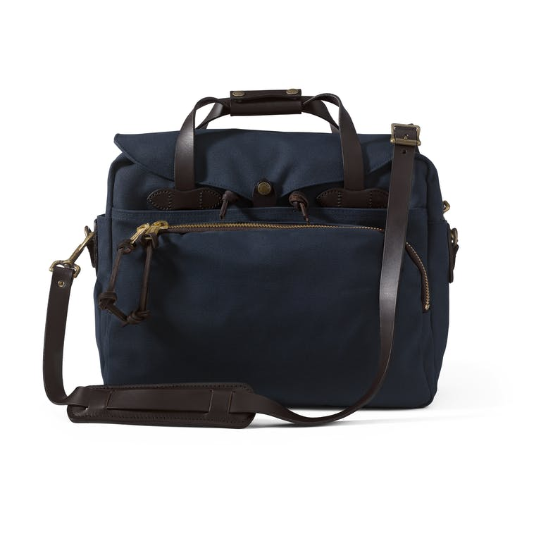 Discover the Filson Padded Computer Bag. Built to resists water and wear, it has a large interior compartment with three dividers and padded computer storage.
