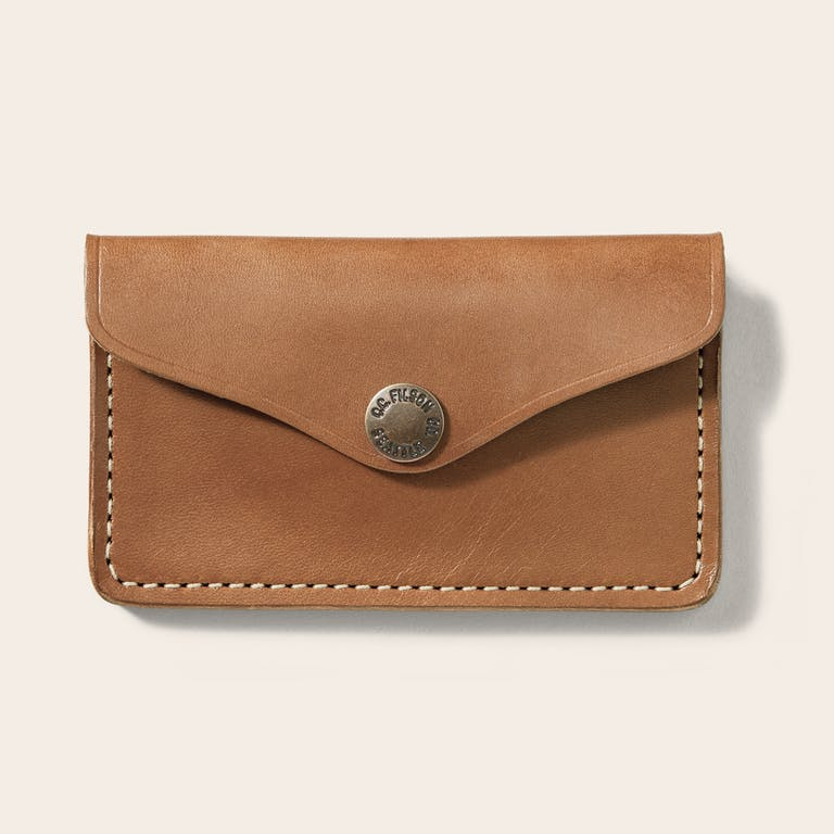 Discover the Filson Bridle Leather Snap Wallet. A Bridle Leather snap wallet with burnished edges and bonded-nylon stitching.
